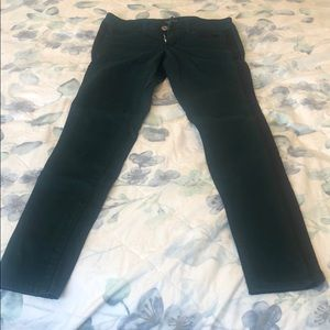 Deep turquoise pants with black stripe